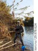 Купить «Man pulling fish on hook», фото № 29978624, снято 27 января 2019 г. (c) Яков Филимонов / Фотобанк Лори