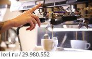 Купить «Barista making coffee. An espresso stream pouring in the cup», видеоролик № 29980552, снято 18 февраля 2019 г. (c) Константин Шишкин / Фотобанк Лори