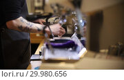 Купить «Barista making coffee. Barista stick out the holder and cleaning it and walks away», видеоролик № 29980656, снято 18 февраля 2019 г. (c) Константин Шишкин / Фотобанк Лори