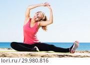 Купить «Woman doing yoga at beach», фото № 29980816, снято 19 февраля 2019 г. (c) Яков Филимонов / Фотобанк Лори