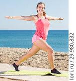 Купить «Charming young female exercising on exercise mat outdoor», фото № 29980832, снято 19 февраля 2019 г. (c) Яков Филимонов / Фотобанк Лори