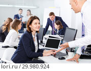 Купить «Friendly coworkers having pleasant fun conversation at workplace in modern office», фото № 29980924, снято 21 апреля 2018 г. (c) Яков Филимонов / Фотобанк Лори