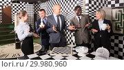 Купить «Smiling businesspeople solving together conundrums», фото № 29980960, снято 29 января 2019 г. (c) Яков Филимонов / Фотобанк Лори