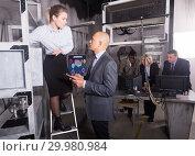 Business colleagues solving conundrum in lost room-lab. Стоковое фото, фотограф Яков Филимонов / Фотобанк Лори