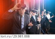 Купить «Excited man in virtual reality room», фото № 29981008, снято 29 января 2019 г. (c) Яков Филимонов / Фотобанк Лори