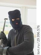 Купить «Robber holding a crowbar», фото № 29996576, снято 29 июня 2012 г. (c) Wavebreak Media / Фотобанк Лори