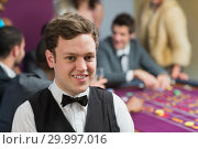 Купить «Dealer standing at roulette table», фото № 29997016, снято 20 июля 2012 г. (c) Wavebreak Media / Фотобанк Лори