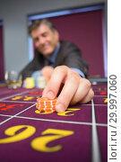 Купить «Man placing roulette bet», фото № 29997060, снято 20 июля 2012 г. (c) Wavebreak Media / Фотобанк Лори
