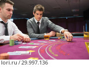 Купить «Man placing bet in poker game», фото № 29997136, снято 20 июля 2012 г. (c) Wavebreak Media / Фотобанк Лори