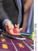 Купить «Man holding dice », фото № 29997188, снято 20 июля 2012 г. (c) Wavebreak Media / Фотобанк Лори