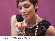 Купить «Woman blowing on dice for luck», фото № 29997240, снято 20 июля 2012 г. (c) Wavebreak Media / Фотобанк Лори