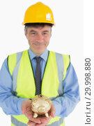 Купить «Architect holding a piggy bank », фото № 29998880, снято 31 июля 2012 г. (c) Wavebreak Media / Фотобанк Лори