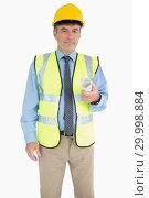 Купить «Architect in vest and helmet holding a plan», фото № 29998884, снято 31 июля 2012 г. (c) Wavebreak Media / Фотобанк Лори