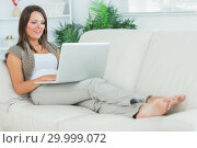 Купить «Cheerful woman lying on the sofa and using her laptop», фото № 29999072, снято 16 августа 2012 г. (c) Wavebreak Media / Фотобанк Лори