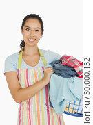 Купить «Smiling woman holding laundry basket», фото № 30000132, снято 8 августа 2012 г. (c) Wavebreak Media / Фотобанк Лори
