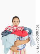 Купить «Exasperated woman holding laundry basket», фото № 30000136, снято 8 августа 2012 г. (c) Wavebreak Media / Фотобанк Лори