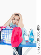 Купить «Woman getting frustrated from amount of ironing to do», фото № 30000400, снято 8 августа 2012 г. (c) Wavebreak Media / Фотобанк Лори