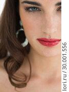 Купить «Woman wearing earrings staring at camera», фото № 30001556, снято 27 августа 2012 г. (c) Wavebreak Media / Фотобанк Лори