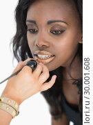 Купить «Woman getting golden lip gloss applied», фото № 30001608, снято 27 августа 2012 г. (c) Wavebreak Media / Фотобанк Лори