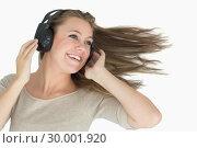 Купить «Smiling woman dancing with a headphone», фото № 30001920, снято 3 сентября 2012 г. (c) Wavebreak Media / Фотобанк Лори