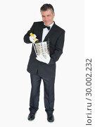 Купить «Waiter offering bottle of champagne in cooler», фото № 30002232, снято 13 августа 2012 г. (c) Wavebreak Media / Фотобанк Лори