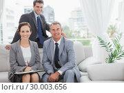 Купить «Smiling partners posing while having a meeting», фото № 30003656, снято 7 апреля 2013 г. (c) Wavebreak Media / Фотобанк Лори
