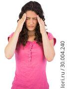 Купить «Young cute brunette suffering from headache», фото № 30004240, снято 17 апреля 2013 г. (c) Wavebreak Media / Фотобанк Лори