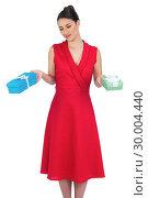 Купить «Content glamorous model in red dress offering presents», фото № 30004440, снято 17 апреля 2013 г. (c) Wavebreak Media / Фотобанк Лори