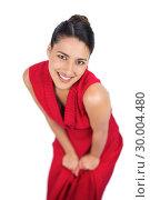 Купить «Cheerful mysterious brunette in red dress posing», фото № 30004480, снято 17 апреля 2013 г. (c) Wavebreak Media / Фотобанк Лори