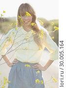 Купить «Smiling hipster girl staring at camera», фото № 30005164, снято 26 апреля 2013 г. (c) Wavebreak Media / Фотобанк Лори