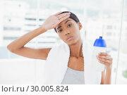 Купить «Exhausted sporty model wiping her forehead after exercising», фото № 30005824, снято 23 мая 2013 г. (c) Wavebreak Media / Фотобанк Лори