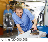 Купить «Workers ironing clothes after cleaning», фото № 30006508, снято 22 января 2019 г. (c) Яков Филимонов / Фотобанк Лори