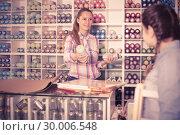 Купить «Female seller in art shop», фото № 30006548, снято 12 апреля 2017 г. (c) Яков Филимонов / Фотобанк Лори