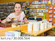 Купить «Female shopper reviews gift boxes», фото № 30006564, снято 19 апреля 2017 г. (c) Яков Филимонов / Фотобанк Лори