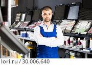 Купить «Auto mechanic standing with crossed arms», фото № 30006640, снято 4 апреля 2018 г. (c) Яков Филимонов / Фотобанк Лори