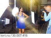 Купить «Professional photo shooting outdoors. Attractive female model po», фото № 30007416, снято 5 октября 2018 г. (c) Яков Филимонов / Фотобанк Лори
