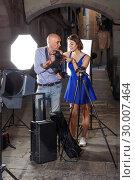 Купить «Photographer talking to jolly female model», фото № 30007464, снято 5 октября 2018 г. (c) Яков Филимонов / Фотобанк Лори
