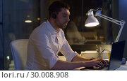 Купить «businessman in headset with laptop at night office», видеоролик № 30008908, снято 11 февраля 2019 г. (c) Syda Productions / Фотобанк Лори