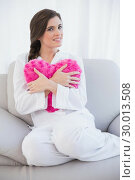 Купить «Peaceful casual brown haired woman in white pajamas hugging a heart shaped pillow», фото № 30013508, снято 18 июня 2013 г. (c) Wavebreak Media / Фотобанк Лори