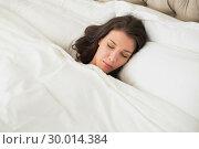 Купить «Peaceful pretty brown haired woman sleeping in her bed», фото № 30014384, снято 20 июня 2013 г. (c) Wavebreak Media / Фотобанк Лори