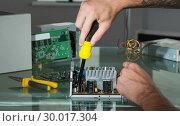 Купить «Hands repairing hardware with screw driver», фото № 30017304, снято 28 июня 2013 г. (c) Wavebreak Media / Фотобанк Лори