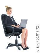 Купить «Focused chic businesswoman sitting on an office chair using her laptop», фото № 30017724, снято 28 июня 2013 г. (c) Wavebreak Media / Фотобанк Лори