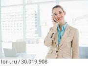 Купить «Cute smiling chic businesswoman phoning with her smartphone », фото № 30019908, снято 17 июля 2013 г. (c) Wavebreak Media / Фотобанк Лори