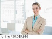 Купить «Lovely smiling chic businesswoman posing with arms crossed smiling at camera», фото № 30019916, снято 17 июля 2013 г. (c) Wavebreak Media / Фотобанк Лори