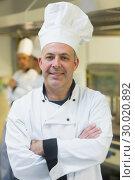 Купить «Proud mature chef posing in a kitchen », фото № 30020892, снято 14 августа 2013 г. (c) Wavebreak Media / Фотобанк Лори
