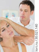 Купить «Calm physiotherapist massaging patients neck with elbow», фото № 30021140, снято 26 июля 2013 г. (c) Wavebreak Media / Фотобанк Лори