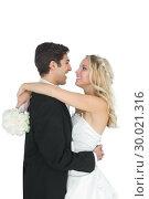 Happy young bridegroom hugging his wife . Стоковое фото, агентство Wavebreak Media / Фотобанк Лори
