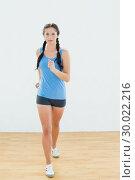 Купить «Sporty woman in jogging posture at fitness center», фото № 30022216, снято 10 июля 2013 г. (c) Wavebreak Media / Фотобанк Лори