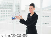 Купить «Smiling businesswoman pointing at graphs in office», фото № 30023656, снято 18 июля 2013 г. (c) Wavebreak Media / Фотобанк Лори