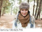 Купить «Woman wearing fur hat with woolen scarf and jacket in woods», фото № 30023716, снято 20 августа 2013 г. (c) Wavebreak Media / Фотобанк Лори